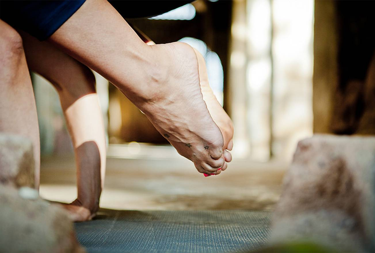 Close up of feet and hands in Yoga pose from Mariza